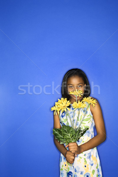 Girl holding flowers. Stock photo © iofoto