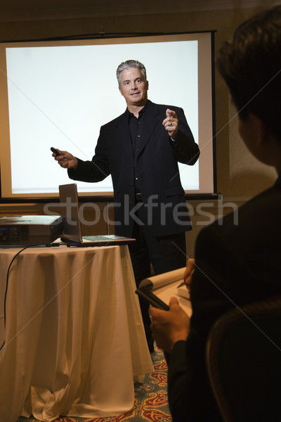 Businessman giving presentation. Stock photo © iofoto