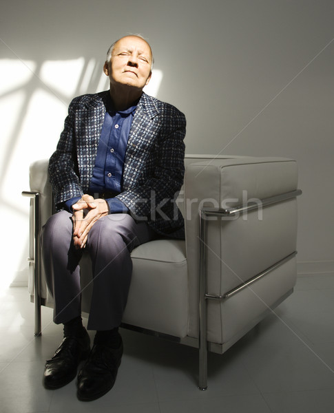 Man sitting in chair. Stock photo © iofoto