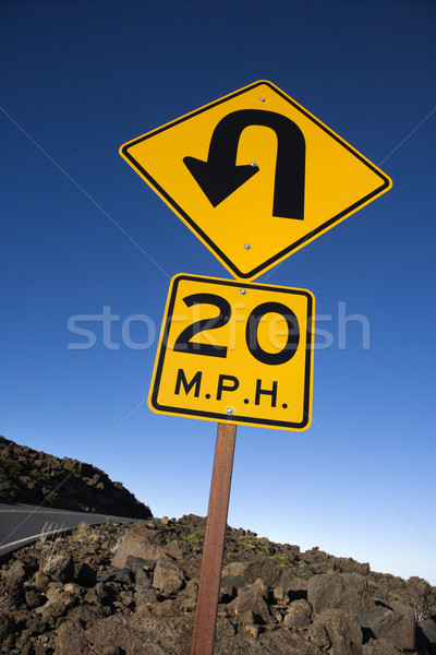 Road curve and speed limit sign. Stock photo © iofoto