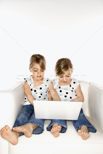 девушки близнецы портативного компьютера женщины детей кавказский Сток-фото © iofoto