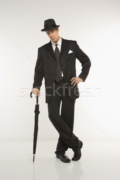 üzletember portré kaukázusi visel fedora dől Stock fotó © iofoto