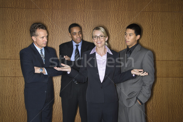 Businesswoman Amongst Businessmen Stock photo © iofoto
