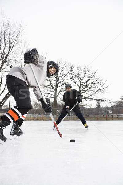 Boys playing ice hockey. Stock photo © iofoto
