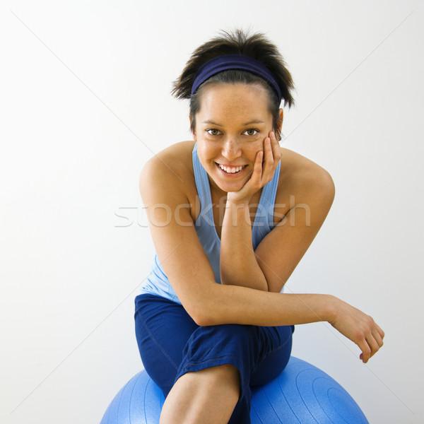 Mosolyog fitnessz nő portré fiatal nő ül fitnessz Stock fotó © iofoto