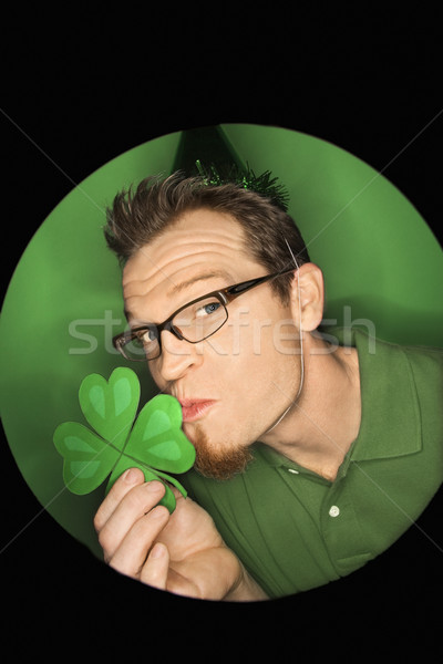 Man kissing shamrock. Stock photo © iofoto