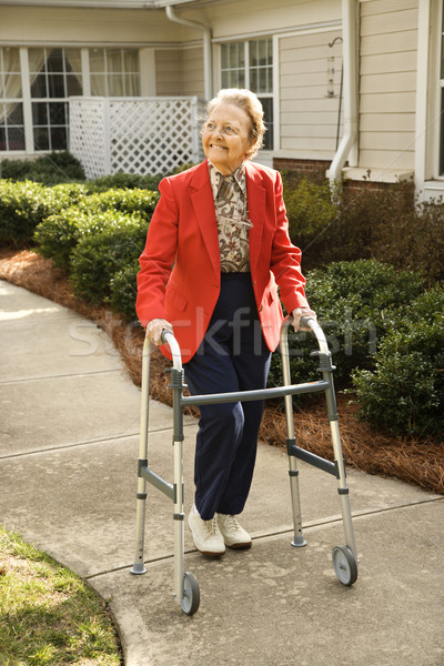 Elderly Woman Using Walker Stock photo © iofoto