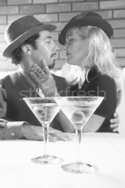 Retro couple with martinis. Stock photo © iofoto