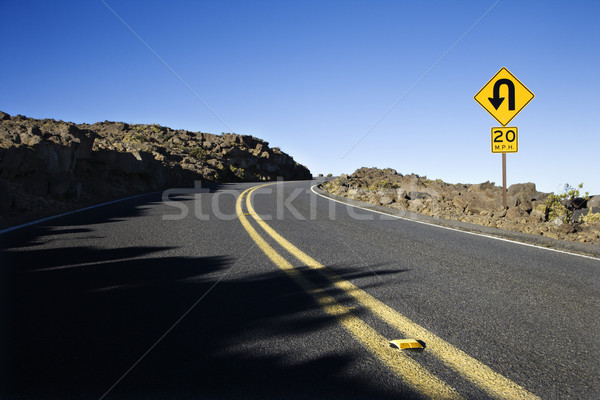 Stock photo: Road with sharp curve sign.