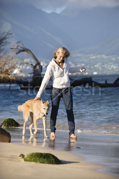 женщину ходьбе собака кавказский коричневая собака привязь Сток-фото © iofoto