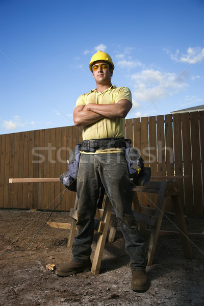 Male Construction Worker Stands with Folded Arms Stock photo © iofoto