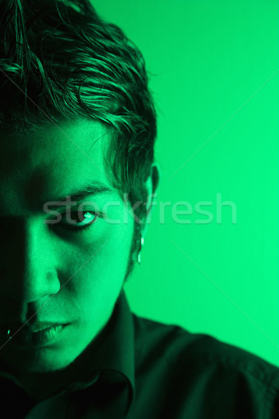 Attractive young man portrait. Stock photo © iofoto