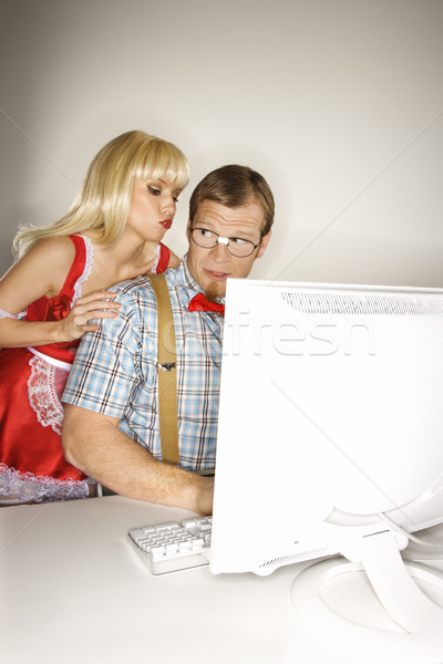 Nerd and maid with computer. Stock photo © iofoto