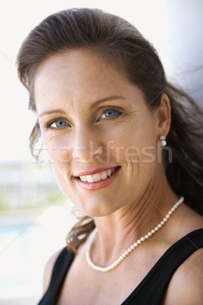 Woman smiling. Stock photo © iofoto