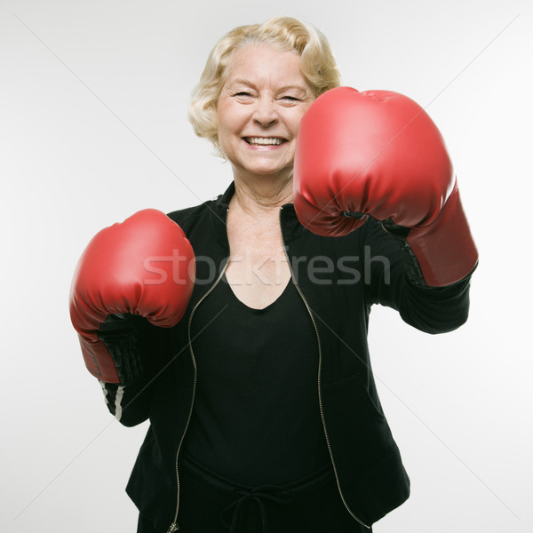 Woman punching. Stock photo © iofoto