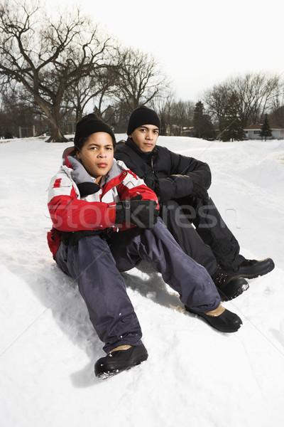 Boys sitting in snow. Stock photo © iofoto