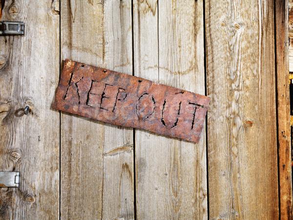 Sign on Old Door Stock photo © iofoto