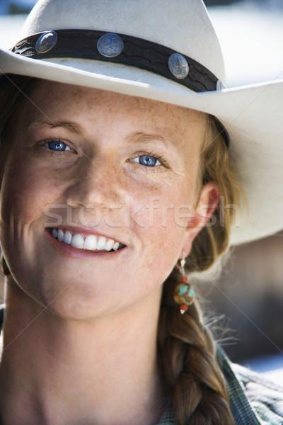 Attrattivo indossare cappello da cowboy sorridere verticale Foto d'archivio © iofoto