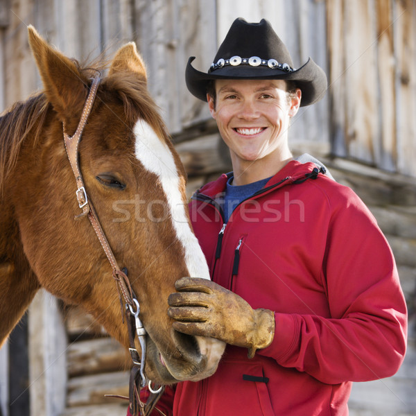 Man petting horse. Stock photo © iofoto