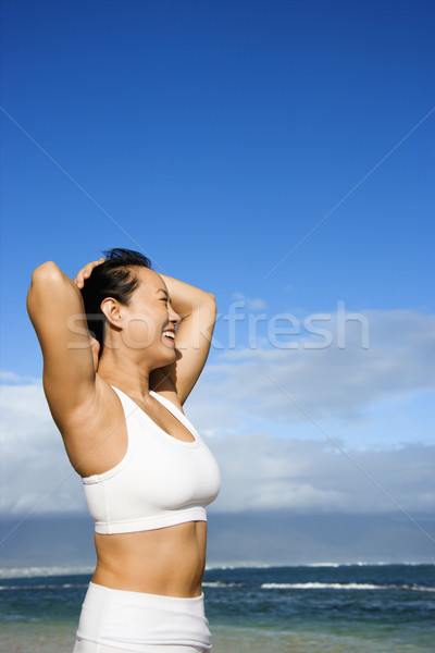 Happy Woman on Beach. Stock photo © iofoto