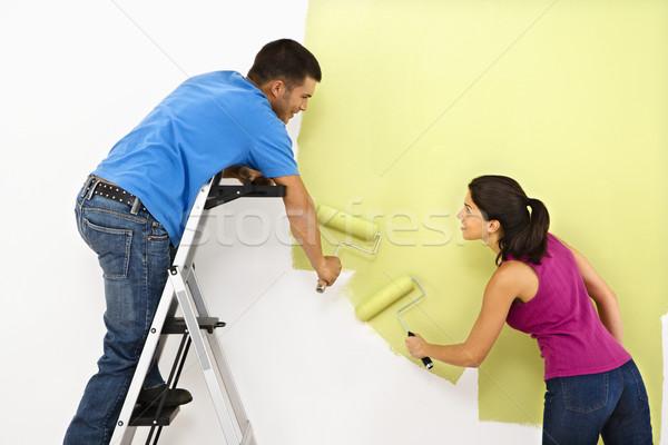 Pár festmény otthon vonzó fiatal felnőtt belső Stock fotó © iofoto