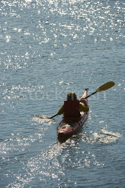 Boy paddling kayak. Stock photo © iofoto