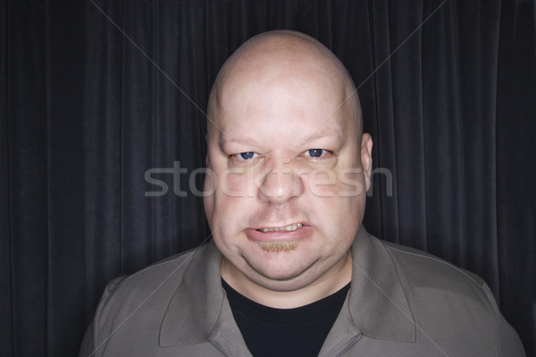 Bald man sneering. Stock photo © iofoto