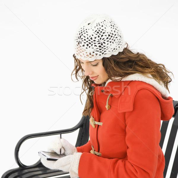 Seduta donna pda femminile Foto d'archivio © iofoto