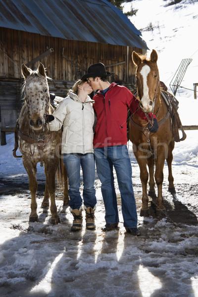 Foto stock: Pareja · besar · caucásico · caballos