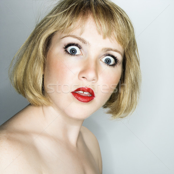 Femme regarder confondre portrait jeunes Photo stock © iofoto