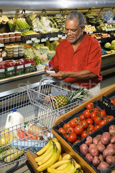 Man grocery shopping. Stock photo © iofoto