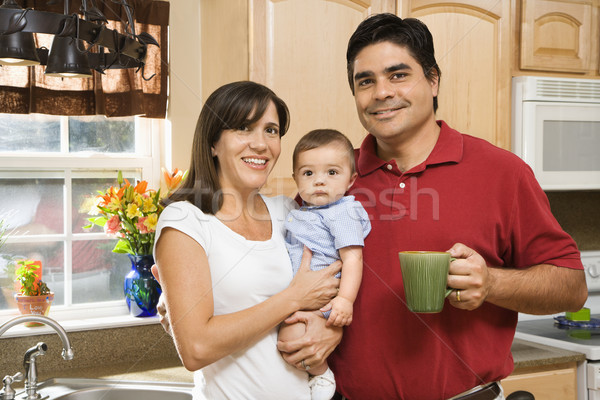Family in kitchen. Stock photo © iofoto