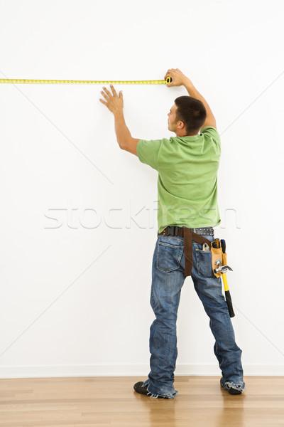 Férfi mér fal visel szerszám öv Stock fotó © iofoto