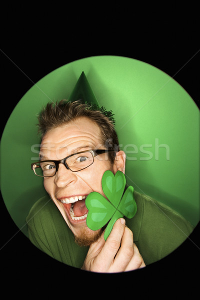 Man holding clover. Stock photo © iofoto