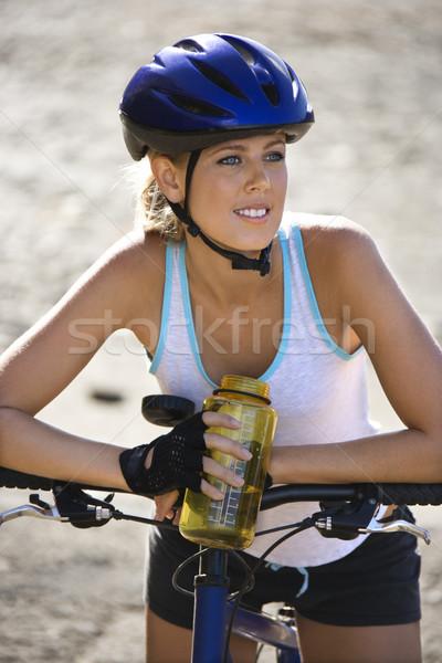 Young woman bicycling. Stock photo © iofoto