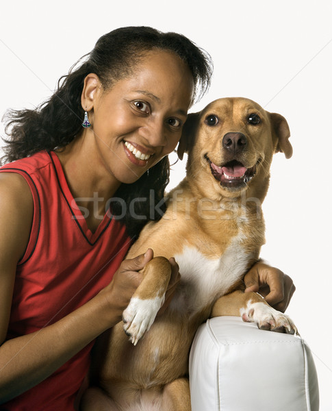 Woman with mixed breed dog. Stock photo © iofoto
