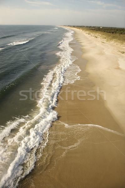 Waves crashing on beach. Stock photo © iofoto