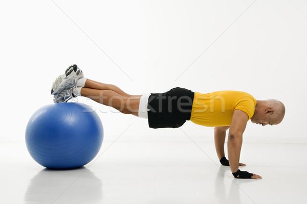 Man doing pushups. Stock photo © iofoto