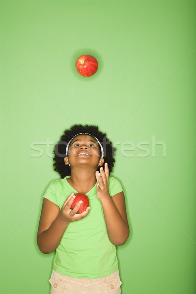 Stock photo: Girl juggling apples.