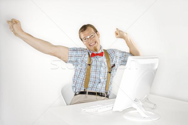 Smiling man with computer. Stock photo © iofoto