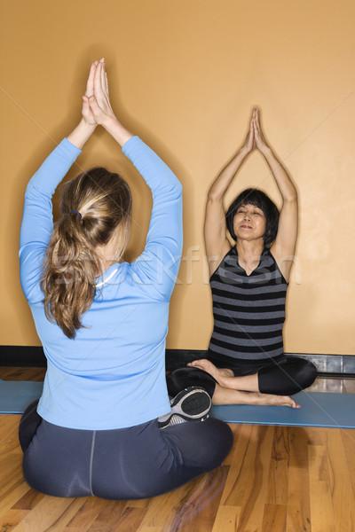 Women doing yoga. Stock photo © iofoto