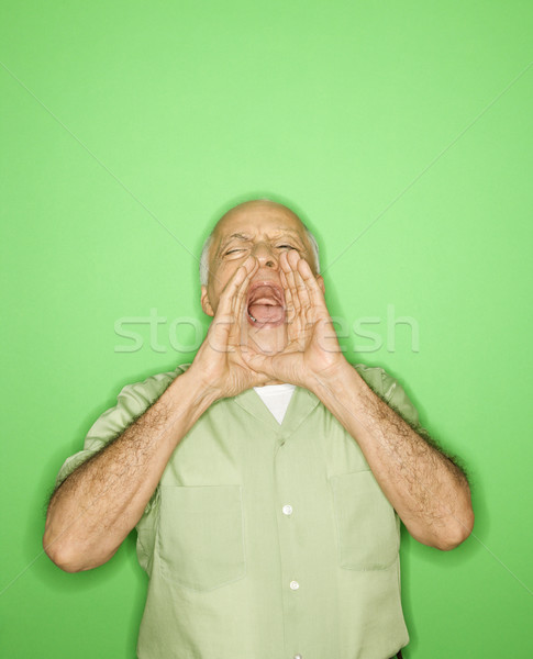 Man with hands to mouth yelling. Stock photo © iofoto