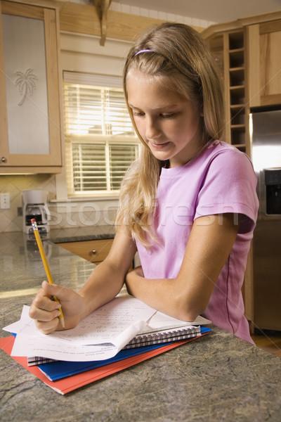 Kız ödev kafkas mutfak tezgahı ev eğitim Stok fotoğraf © iofoto