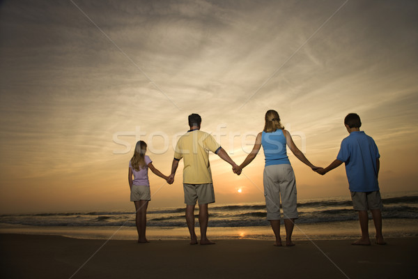 Family holding hands on beach Stock photo © iofoto