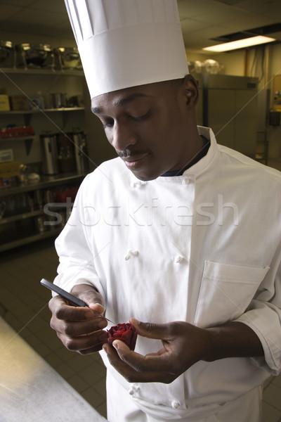 Chef carving beet. Stock photo © iofoto
