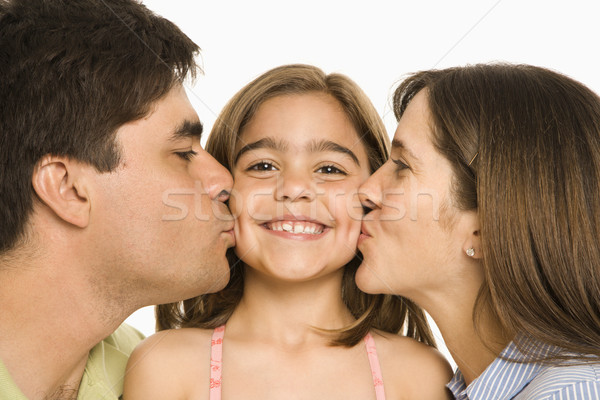 Parents kissing girl. Stock photo © iofoto