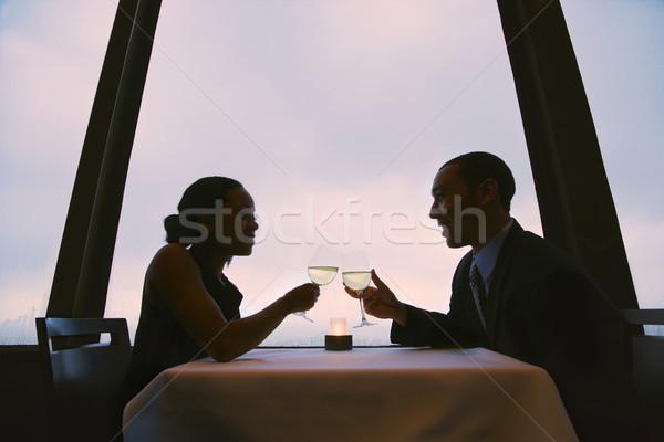Pár pirít szemüveg borospoharak nők férfiak Stock fotó © iofoto