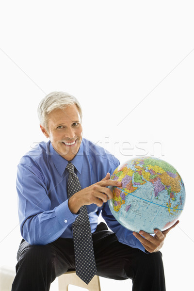 Biznesmen świecie w średnim wieku człowiek wskazując Zdjęcia stock © iofoto