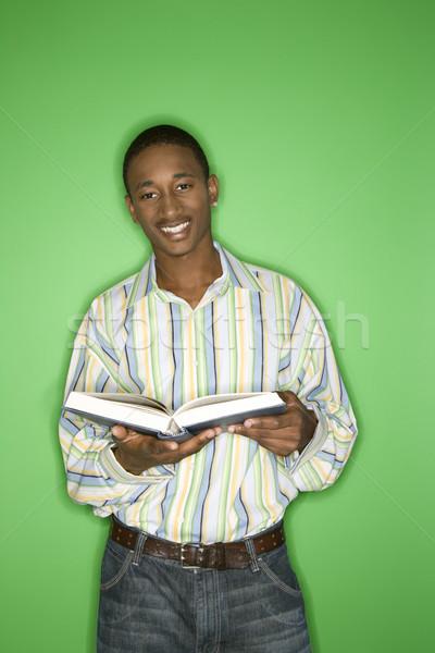 Czytania portret uśmiechnięty teen chłopca Zdjęcia stock © iofoto