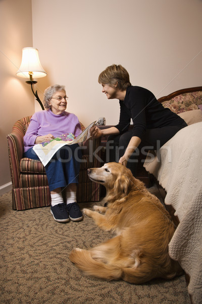 Elderly Woman With Younger Woman and Dog Stock photo © iofoto